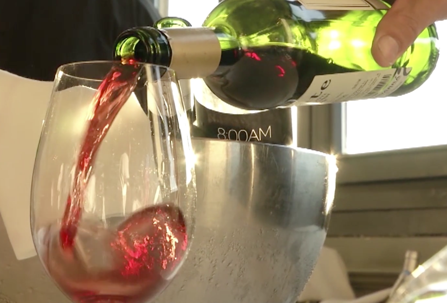 A glass of 8:00AM Navarran wine is poured at a private event in Pamplona during the Running of the Bulls