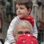 father-son-enjoying-san-fermin-festival-in-pamplona