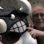 man-hanging-with-angry-bull