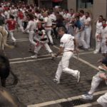 runners and bulls on estafeta street pamplona